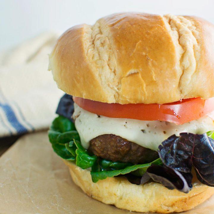 Harvarti, heirloom tomatoes and artisan lettuce top the best Flippin' Burger! Recipe @LittleFiggyFood