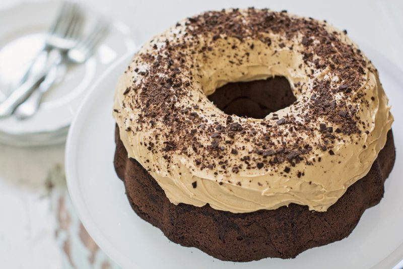 A lovely Cardamom Chocolate Bundt Cake recipes topped off with an oh so creamy frosting! Recipe @LittleFiggyFood