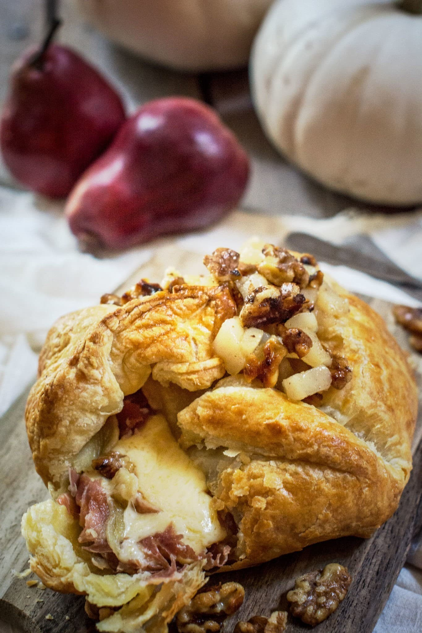Make this gorgeous appetizer for your next get together, Bake Gouda! It's full of layers of flavors, wrapped in Prosciutto, then baked in a puff pastry and topped off with a warm Pear and Walnut Compote! Get the recipe at Little Figgy Food.
