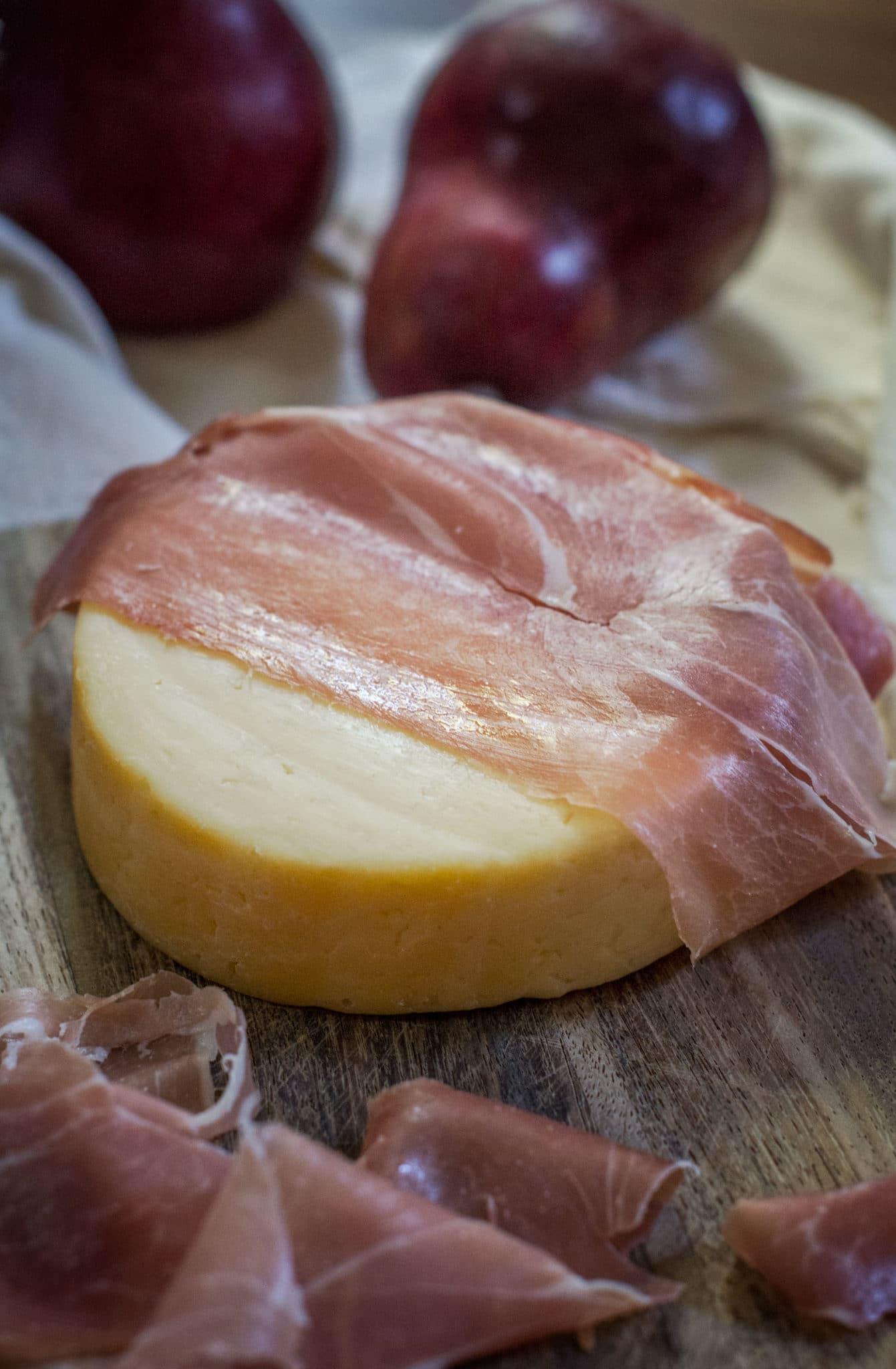 Prosciutto wrapped smoked Gouda cheese