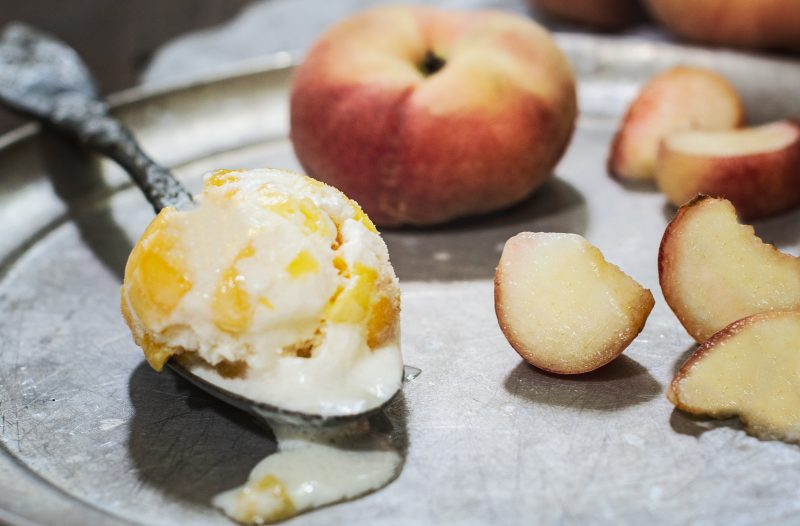 Homemade Peach Ice Cream on a spoon.