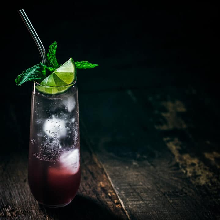 Mulled winter sangria mixed drink with lime and mint